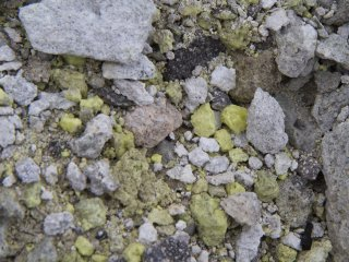 You'll see sulfur, the yellow-green rocks, all around the top of this volcano