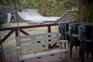 Porch swing and skateboarding ramp