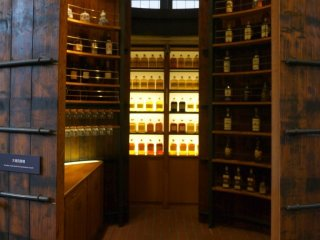 Wooden shelves lined with whiskey bottles create a wonderful atmosphere