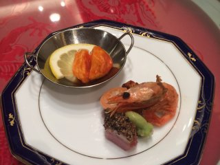 Appetizer. The courses here are delicately presented in a way that is similar to French or Japanese Kaiseki style. The porkin a sweet and spicy sauce flavored with star anise is appealing.