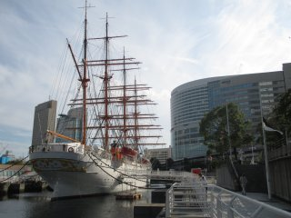 Resting between towers is the Nippon Maru, a ship built in 1930 that now serves as an exhibition area