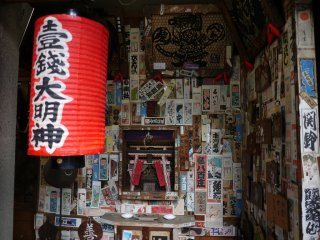 A tiny shrine opposite Minamiza Theater is almost completely covered in pilgrim stickers!