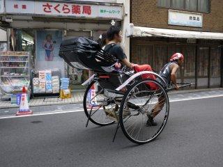 A rickshaw bowls along Higashioji Street