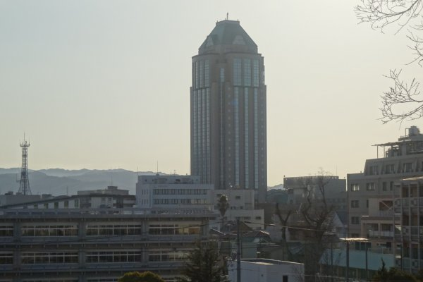 The Imabari Kokusai Hotel looms over the city skyline at dusk