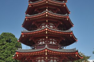 An imposing pagoda amid other majestic buildings