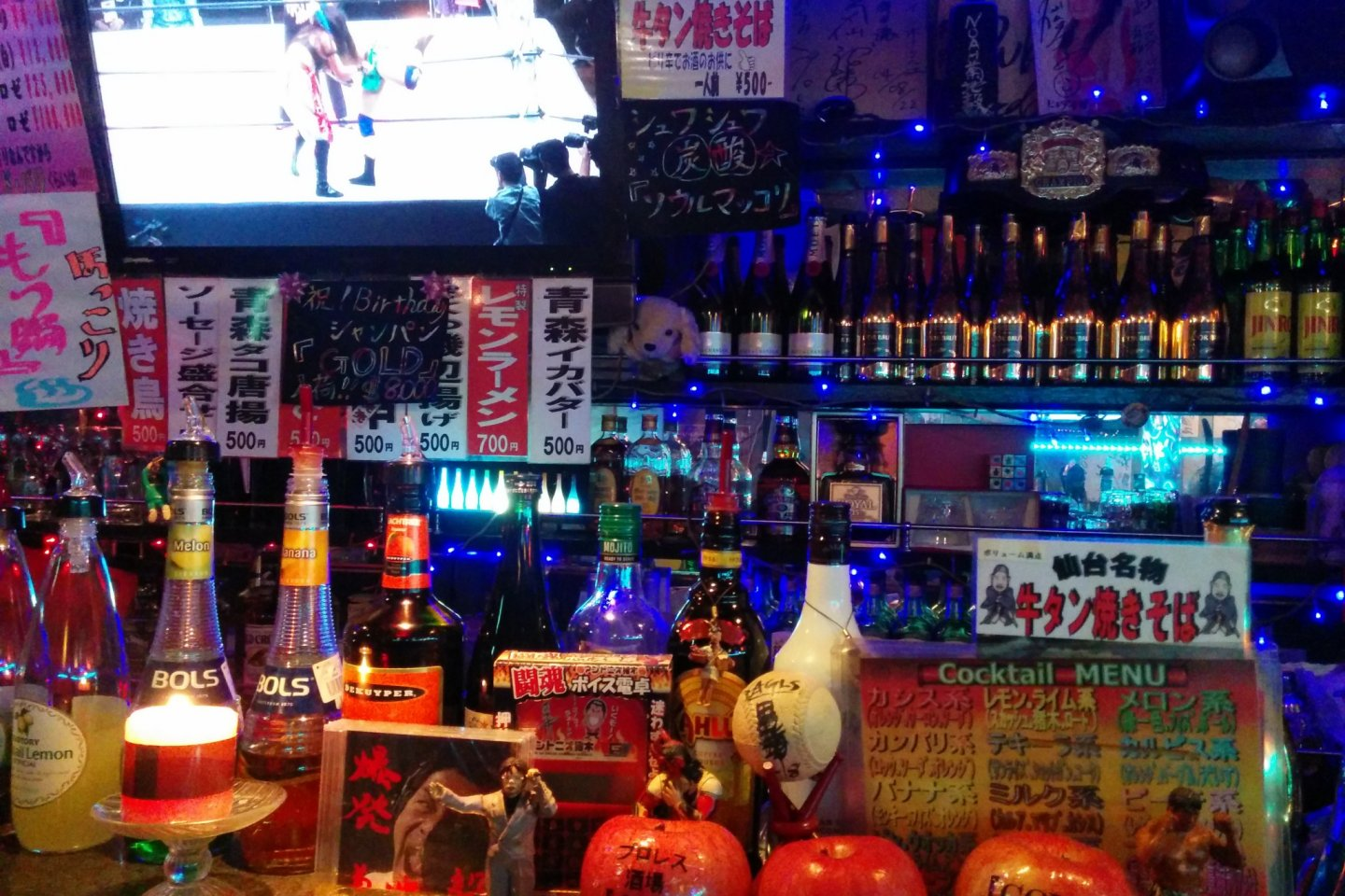 The bar counter with TV monitor in back