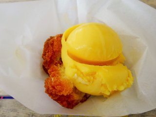 Andagi (Okinawan donuts) with tropical flavored ice cream are sold at one of the shops