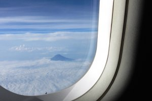 You can see a glimpse of Mount Fuji from the left hand side going from Osaka to Narita.