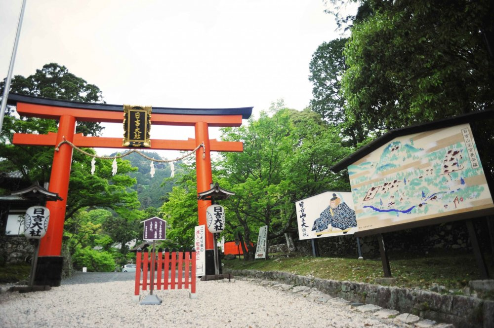 Entrance to the Hiyoshi Taisha Shrine at the foot of Mount Hiei. Stairs leading to the mountain path lie to the left of the torii gate
