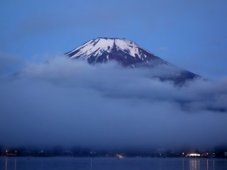 The mass of the mountain seems impossibly huge against the dim sky