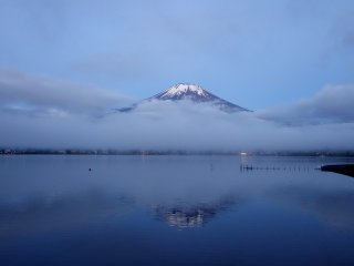 "It is still calm across the lake surface, perfect conditions for reflecting Mt. Fuji (known as ""Sakasa Fuji"" or Upside-down Fuji)"