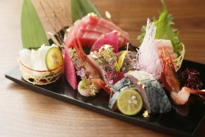The sashimi is topped with gold flakes