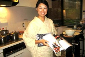 Kaori uses her collection of cooking and culture books to explain Japanese Cuisine