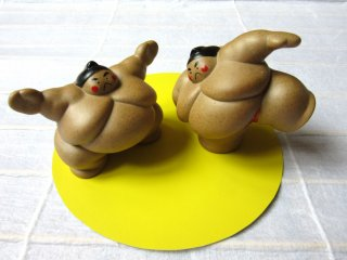 Sumo is a Japanese national sport and is very important. Every time I watched TV news, they ended with sumo news, so I picked this pair!