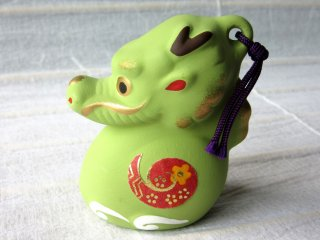 Tetsu (a dragon) was year 2012. Another version of a souvenir is a ceramic bell.