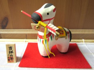 Year of the Uma (a horse)! This was made of paper mache and has an arrow that is very typical of a New year in Japan.