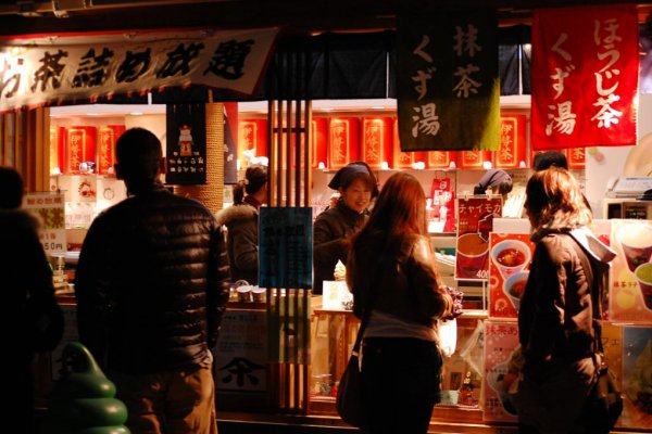 Visitors to Ise Jingu pass food vendors in the shopping streets near the shrine.