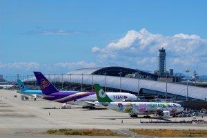 Planes and Kansai International Airport's terminal building.