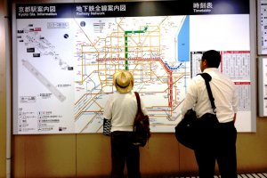 Large city maps at each subway station show the way to popular attractions in Kyoto.