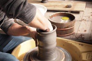 An artisan creates a pot with the ease of a master