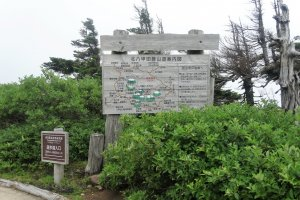 A signboard details the trails