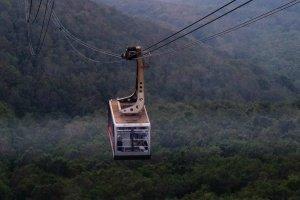 A ropeway car makes its way down the Hakkoda mountains