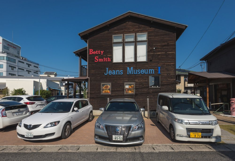 The outside of Part I of the jeans museum. This includes a display area and store.