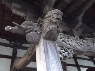 Some of the detailed carvings under the eaves of the hall