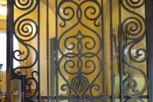 A beautiful iron gate greets visitors at the entrance