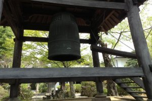 A very large bell at the top of the stairs. A sign says do not ring the bell. It is very tempting, being so large.
