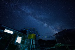 The amazing starry sky and Milky Way over the hut