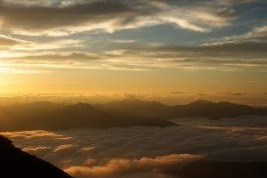 The golden light of sunrise over the valley
