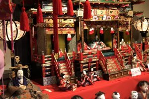 A set of hina-dolls in a miniature palace