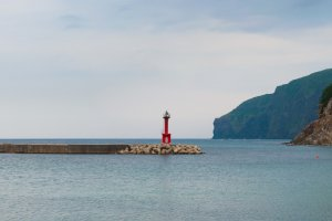 The lighthouse stands in the middle of the bay as a warning to boats who use the Funabiki canal.