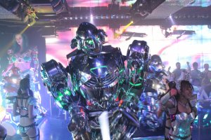 Robots march down the stage and show off their shiny armor.