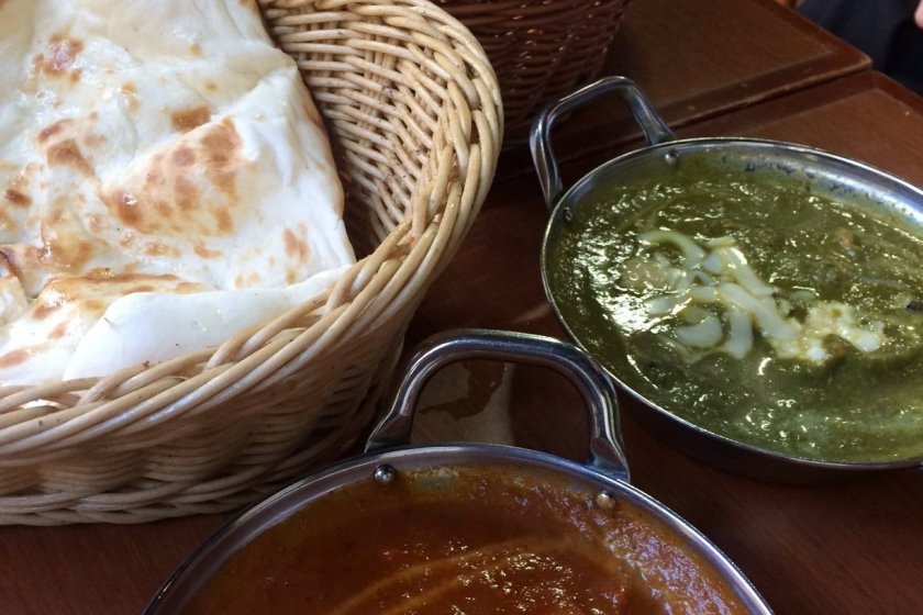 Spinach chicken curry and keema curry with naan