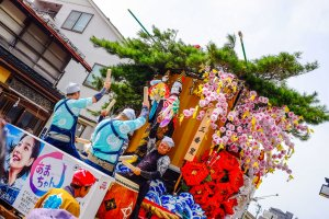 At the front of the float the children play the Taiko drums and at the back the adults play larger drums