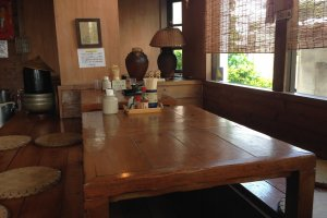 There are five tables and four tatami style tables to sit at