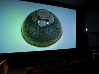 "Theater 4000: This is the name of the screening room where high resolution digital images are displayed. 2 films are shown here: ""Silk Road, Buddha in Dunhuang"" and ""Marine Shosoin, Okinoshima""."