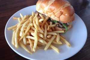 The Philly cheesesteak sandwhich comes with shoestring french fries