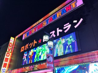 At the entrance of the Robot Restaurant, top of the building