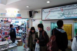 Ticket machines alongside a convenient store.