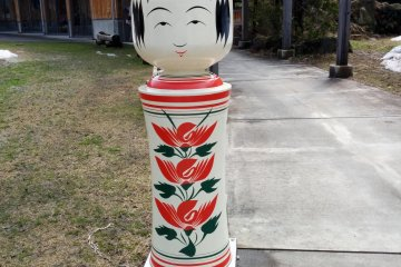 <p>A plus-sized kokeshi doll welcomes you as you approach the front entrance.&nbsp;</p>