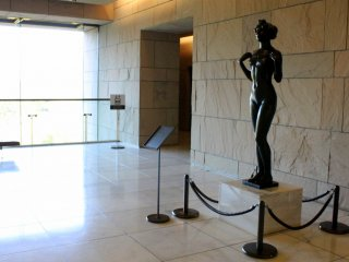 At the lobby, this voluptuous stone statue guards the entrance to the Golden Tea Room.