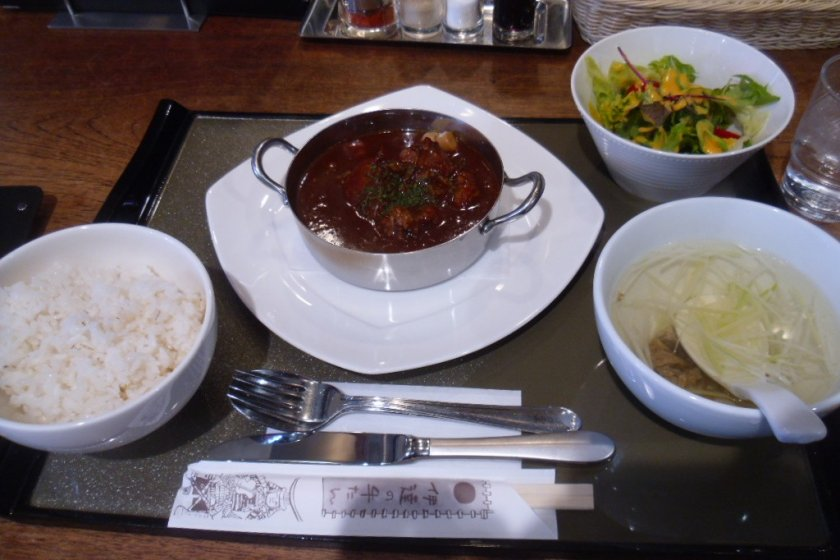 Gyutan stew, served with the traditional barley rice and ox tail soup, as well as a salad.