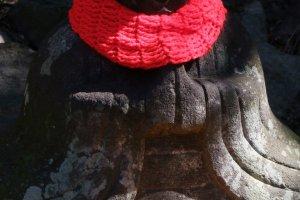 Beautiful Buddhist statue along a mountain side road.
