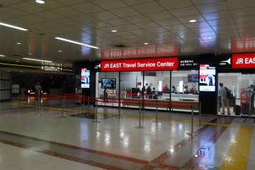 Down the escalator and you will find the JR East Travel Service Center