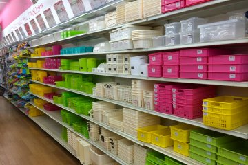 <p>The plethora of bright, colorful containers here will help you envision&nbsp;just how organized your shelves at home can look!</p>