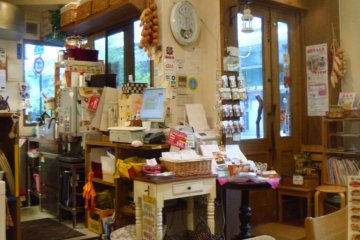 <p>The store is bright and welcoming, with a decent number of seats.</p>