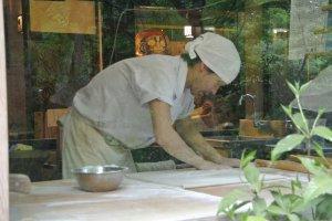 Soba artisan making sSoba in the window
